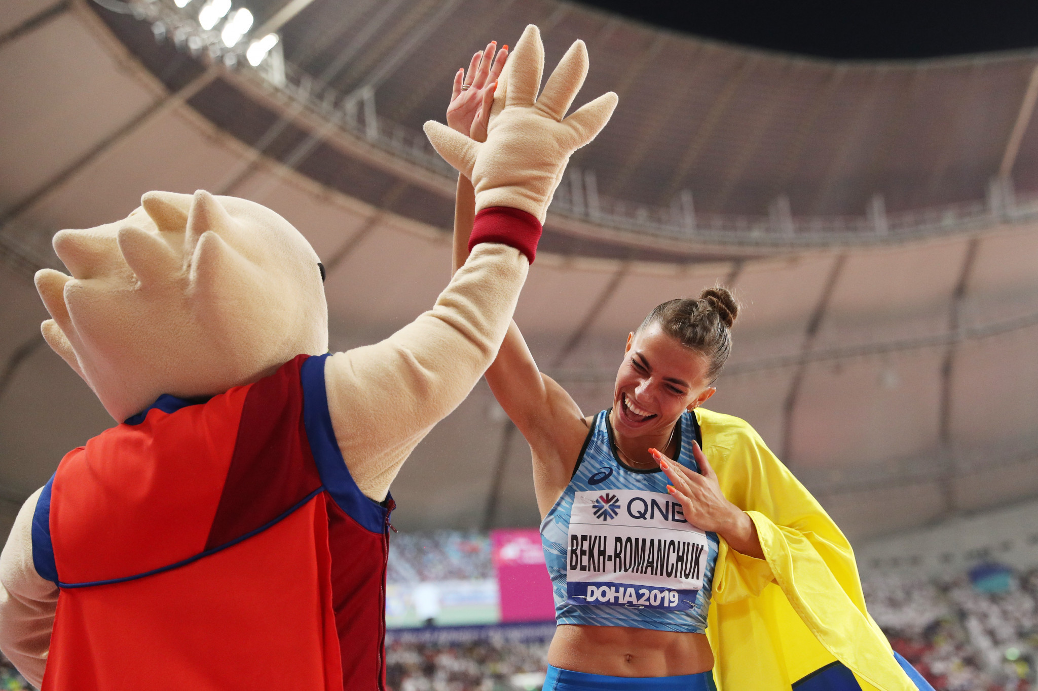 Maryna Bekh-Romanchuk of Ukraine celebrates her silver medal in the women's long jump with a fan