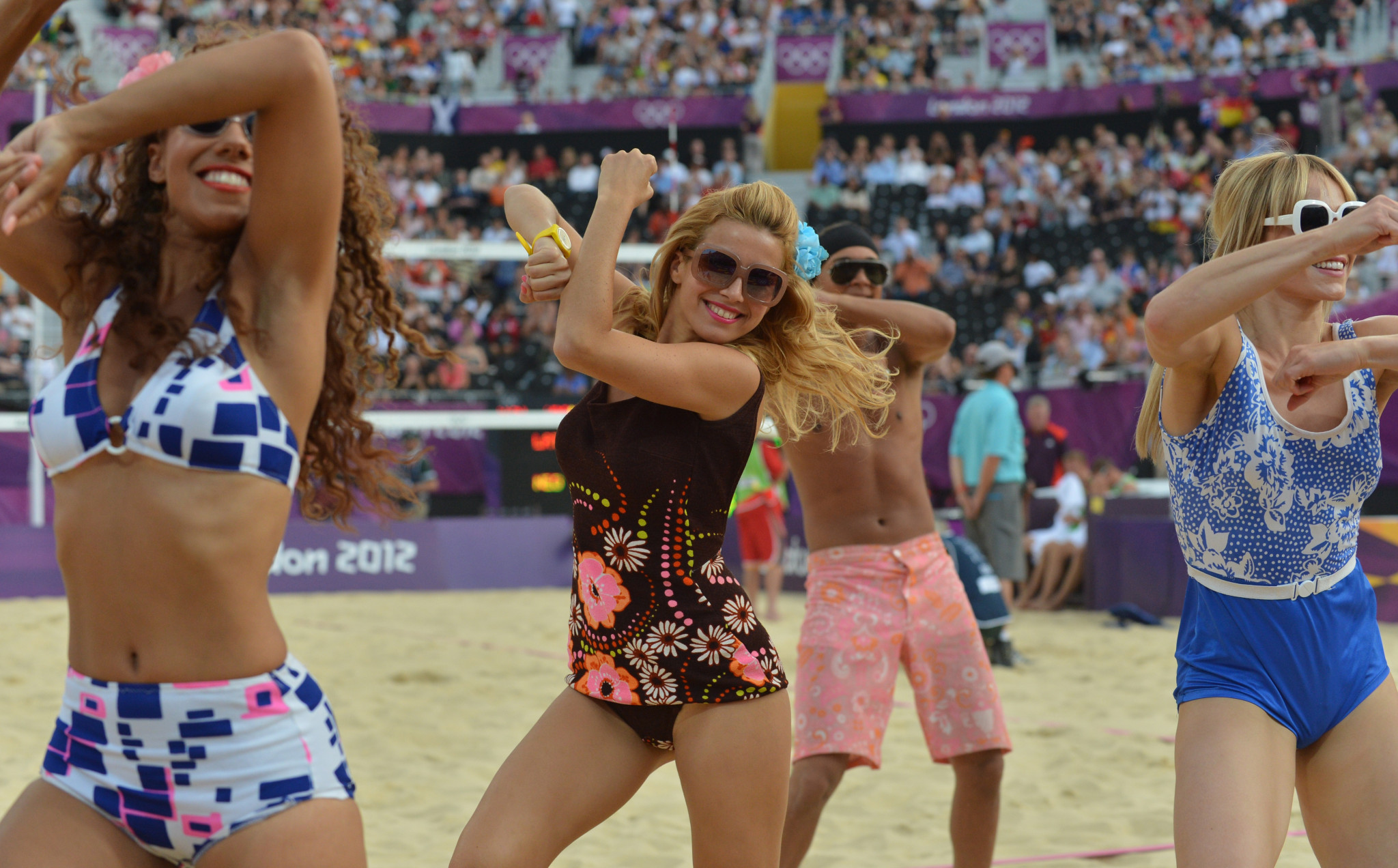 London 2012 promised top-level entertainment during the beach volleyball but ended up offering young dancers gyrating along to the theme track from the Benny Hill Show ©Getty Images