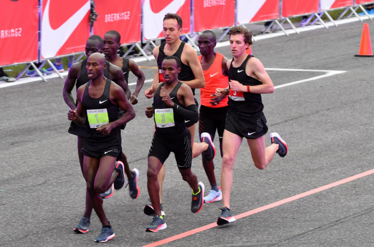 Pacemakers shield Eliud Kipchoge from the wind during the 2017 attempt to break two hours for the marathon as part of Nike's Breaking2 project at the Monza race circuit ©Getty Images