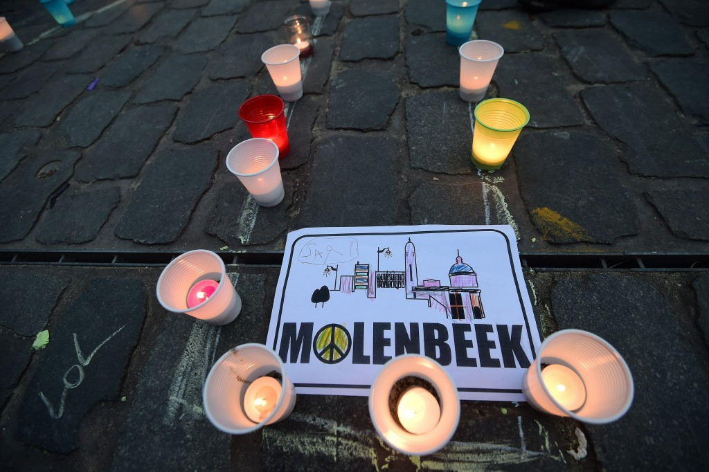 A candle light vigil to the victims of the Paris attacks in Brussels' Molenbeek district. The area's football club is finding new life