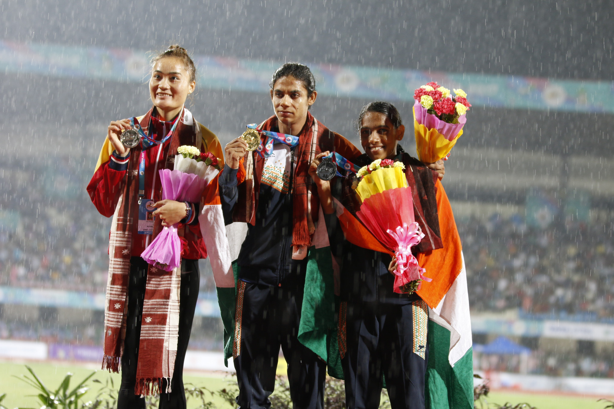 India's Nirmala Sheoran, centre, had won two gold medals at the 2017 Asian Championships in Bhubaneshwar ©Wikipedia