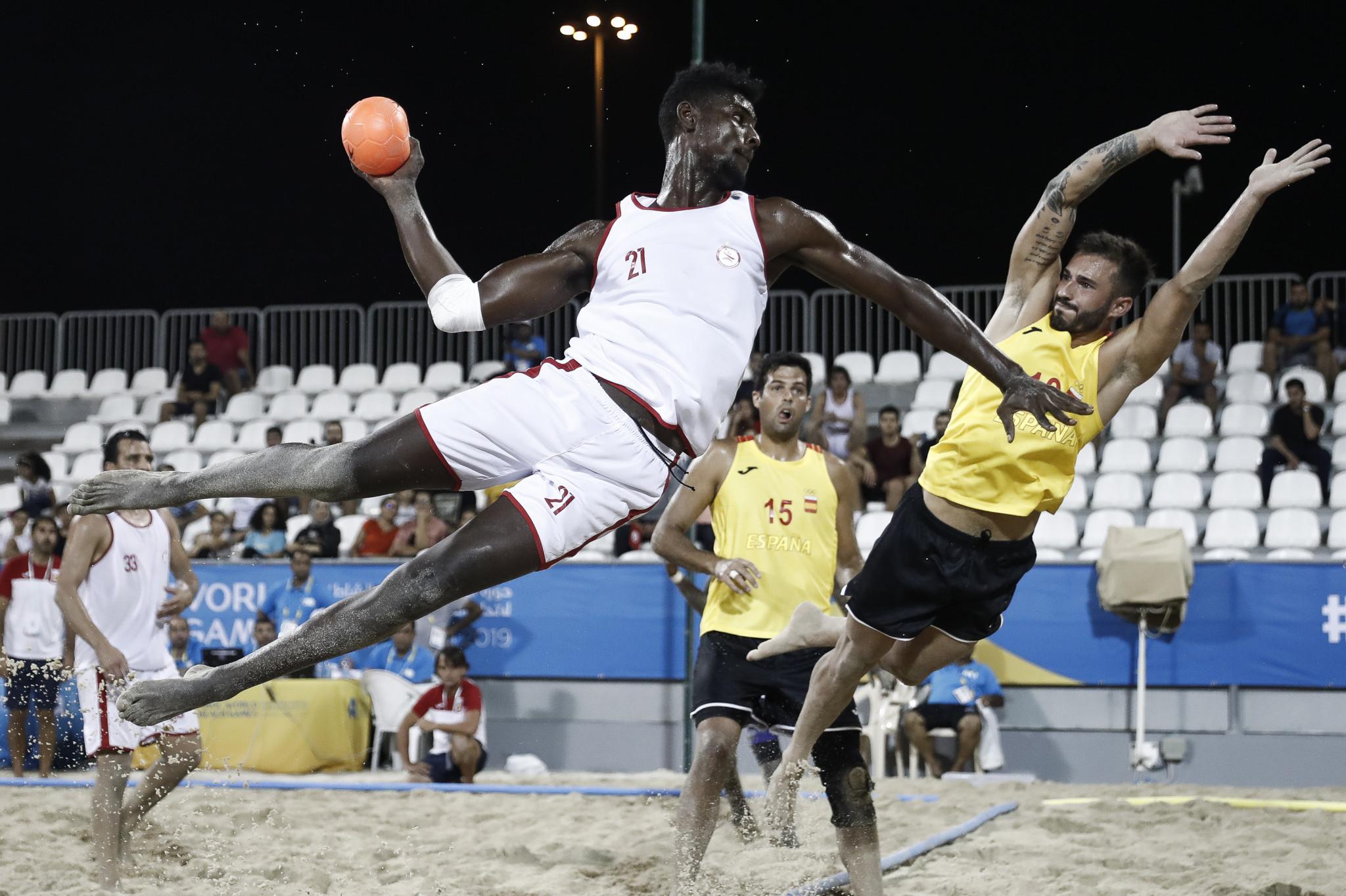 Beach handball players take to the air ©ANOC
