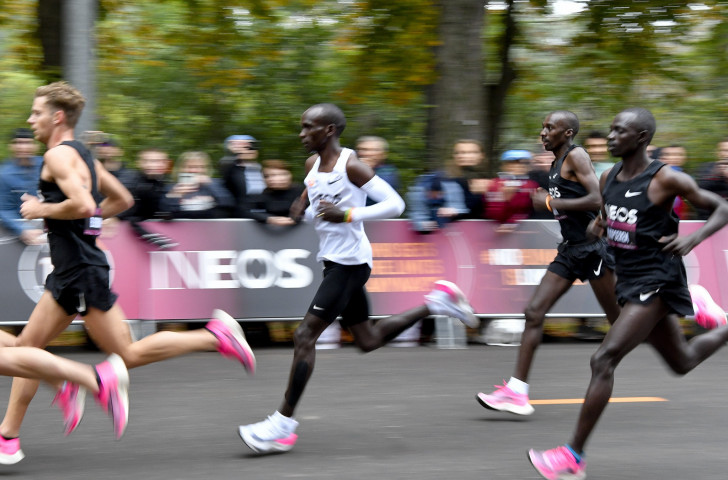 Eliud Kpchoge was helped to his target in Vienna today by 35 pacers running in shifts of seven every three kilometres ©Getty Images