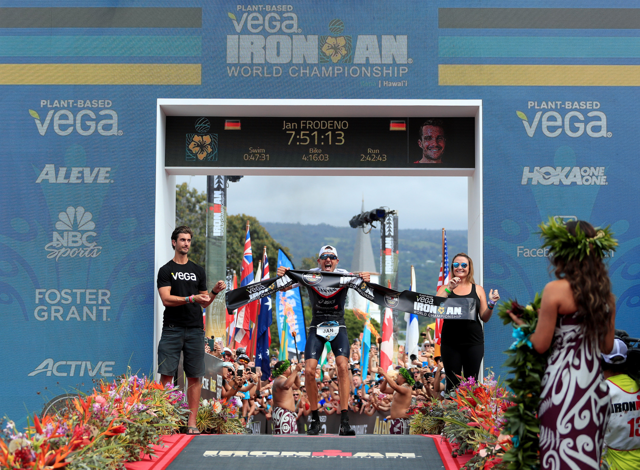 Frodeno regains Ironman world title with course record as German compatriot Haug wins first women's gold