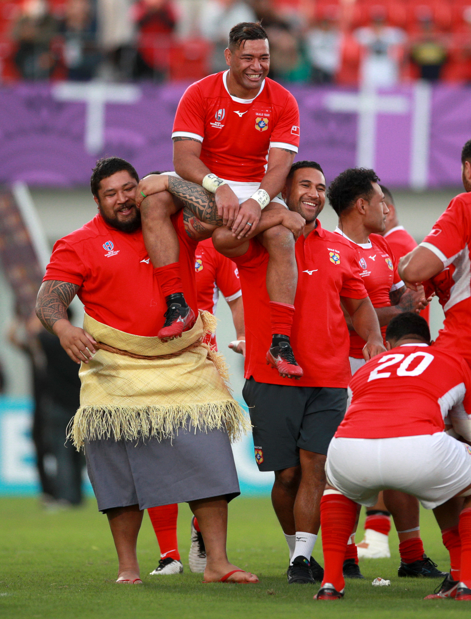 Siale Piutau of Tonga is carried off the pitch after his country's 31-19 win against the United States ©Getty Images