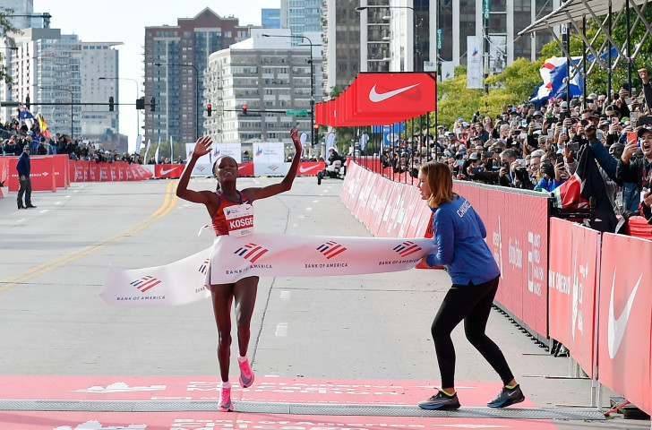 Kenya's Brigid Kosgei breaks the 16-year-old world record for the women's marathon in Chicago, clocking 2 hour 14min 04sec = a performance that race director Carey Pinkowski believes may have been inspired by Kipchoge ©Getty Images