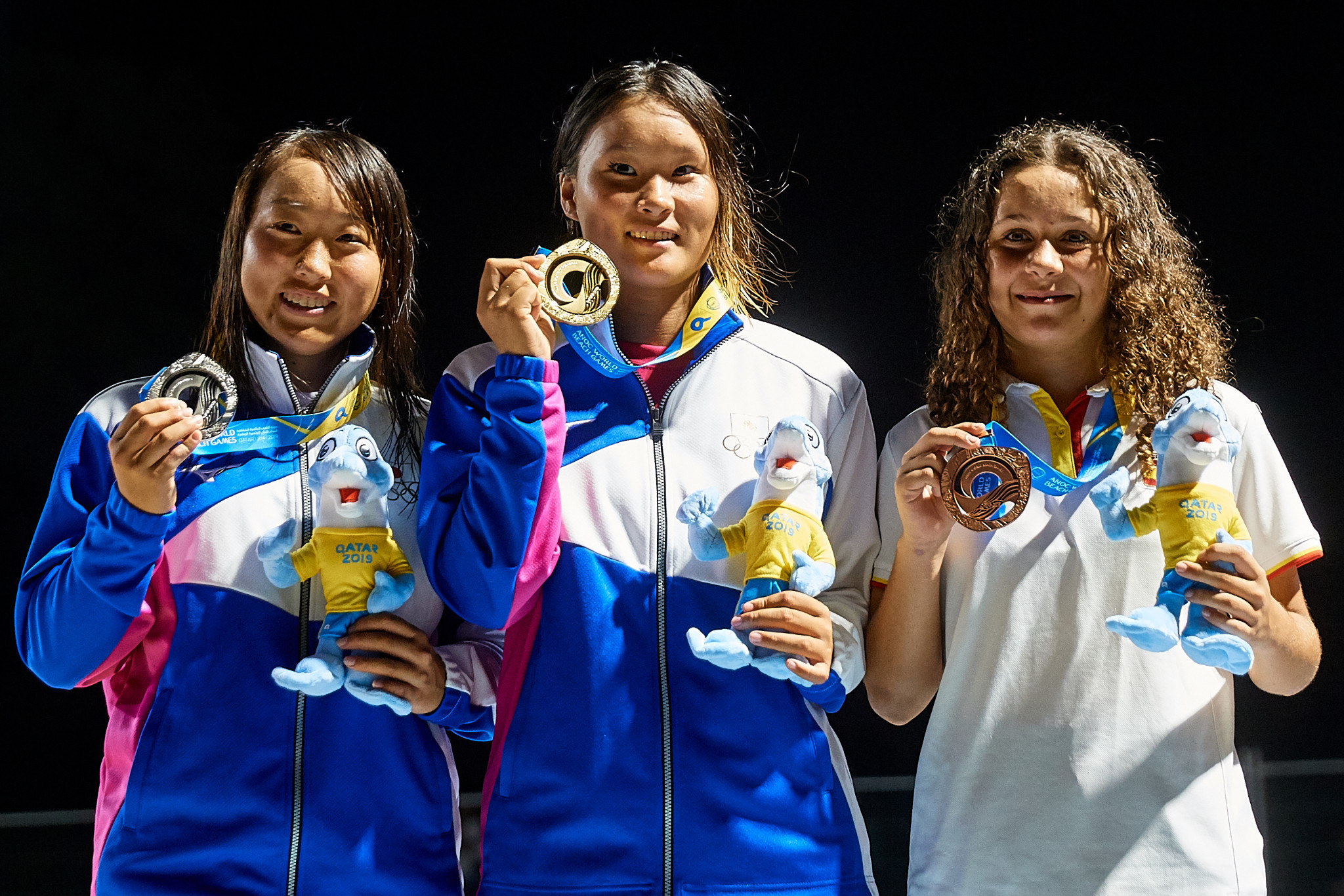 Sakurai Yosozumi, centre, was joined on the podium by team-mate Kihana Ogawa, who won the silver medal, and Spain's Julia Benedetti, who took bronze ©ANOC World Beach Games