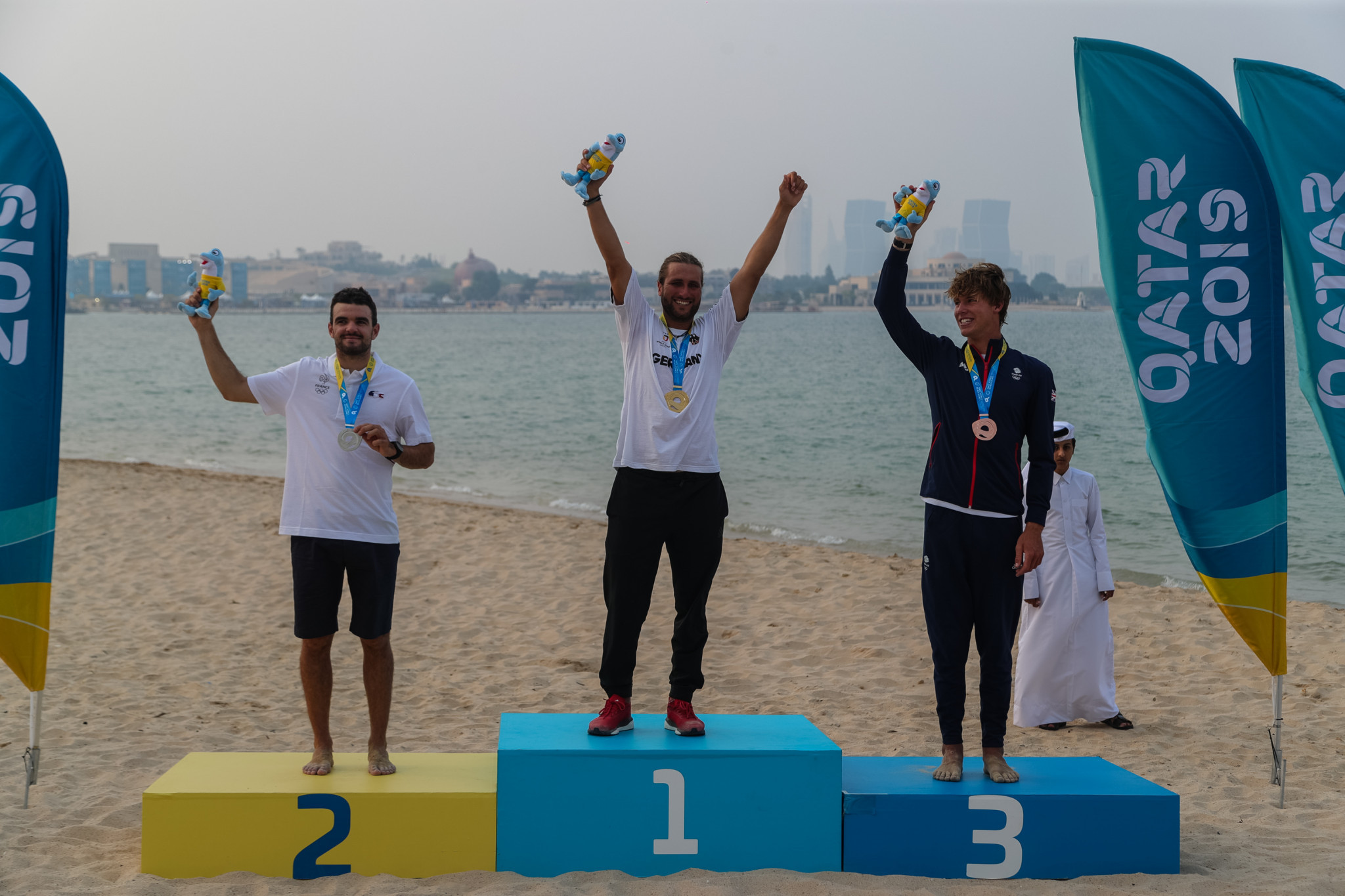 Florian Gruber of Germany won the first medal of the final day in the men's kitefoil ©ANOC