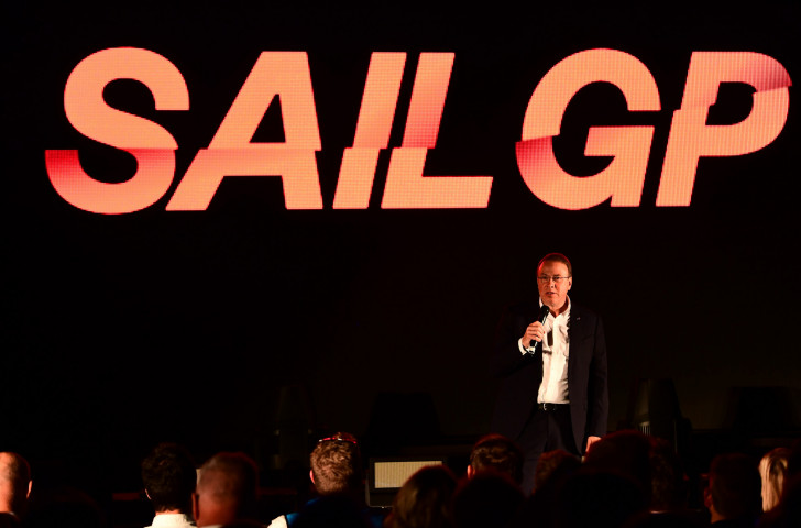 Andy Hunt, pictured making a presentation as chief executive of World Sailing last year, has stepped down from his post to take up a new international role next year ©Getty Images