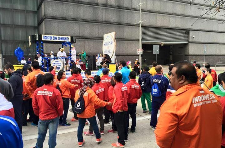 A number of athletes competing at the World Weightlifting Championships took part in the parade
