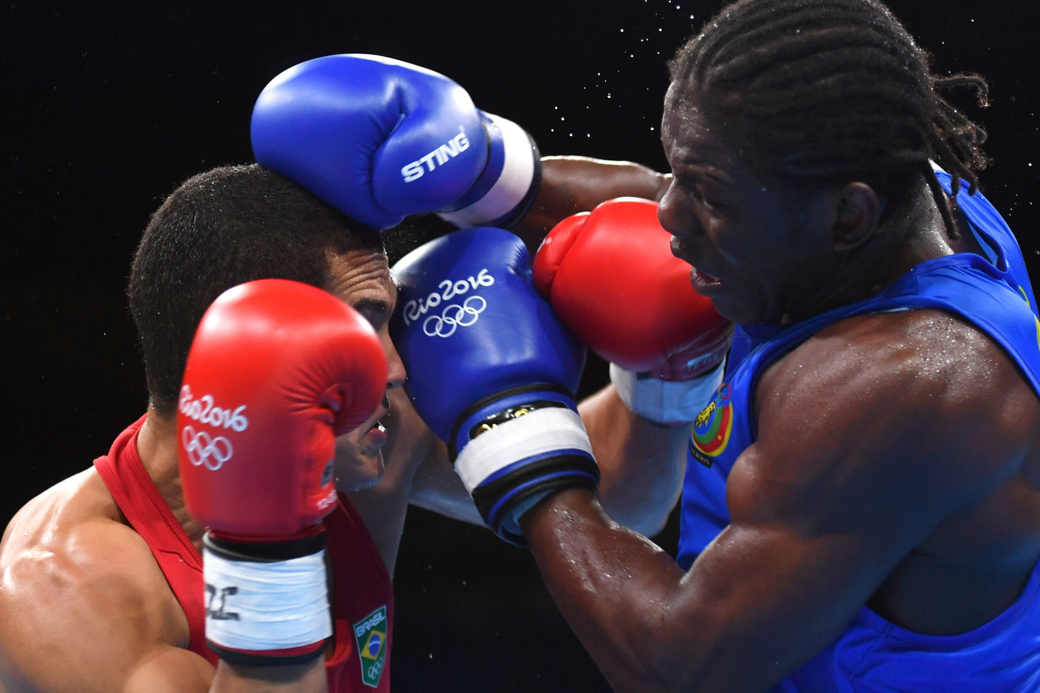 Cameroon's Hassan N'Dam, in blue, was one of three professional boxers to compete at Rio 2016 but he was beaten in the opening bout by Brazil's Michel Borges in the 81-kilograms category ©Getty Images