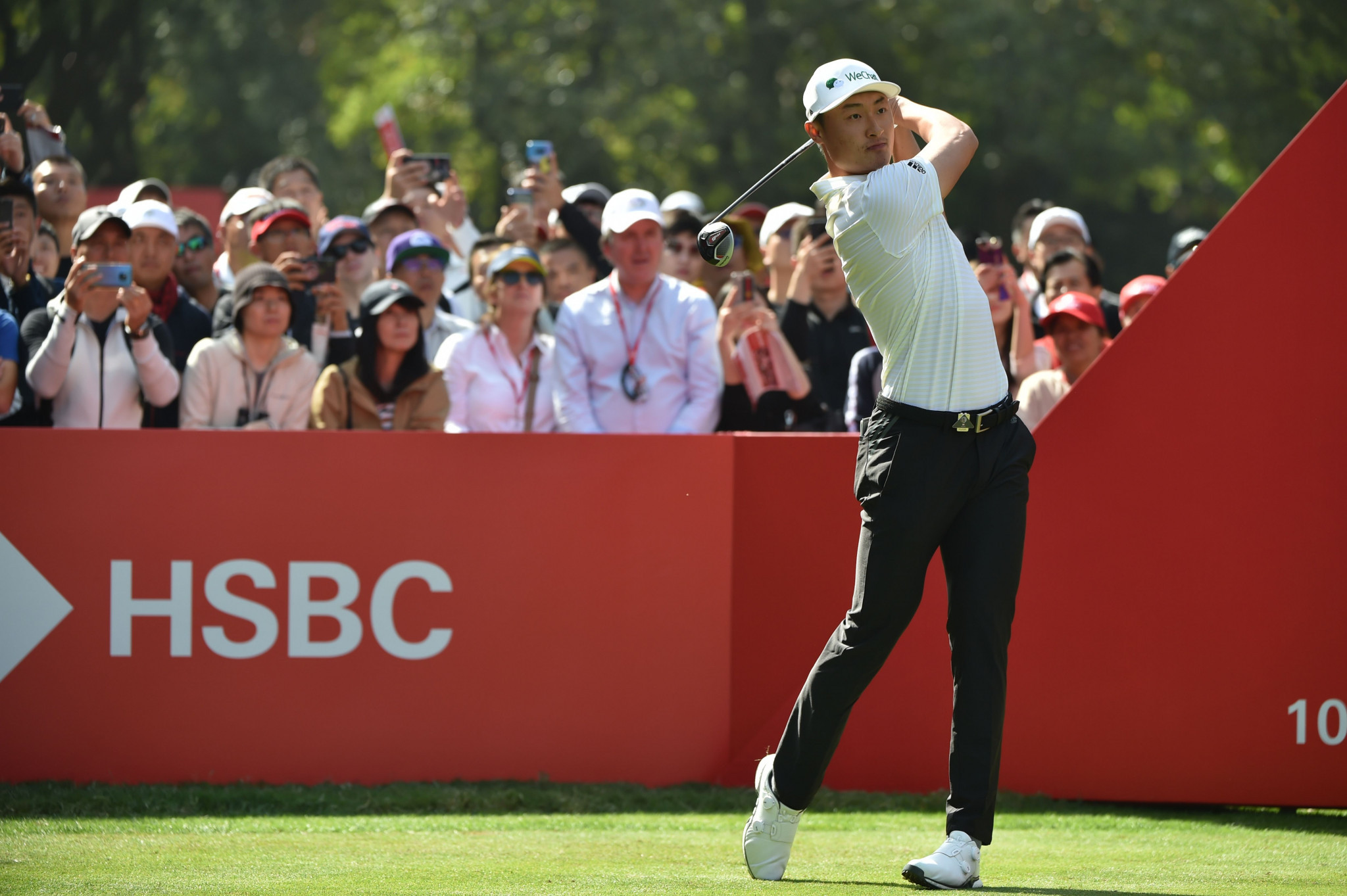 Li on top with McIlroy solid at WGC-HSBC Champions