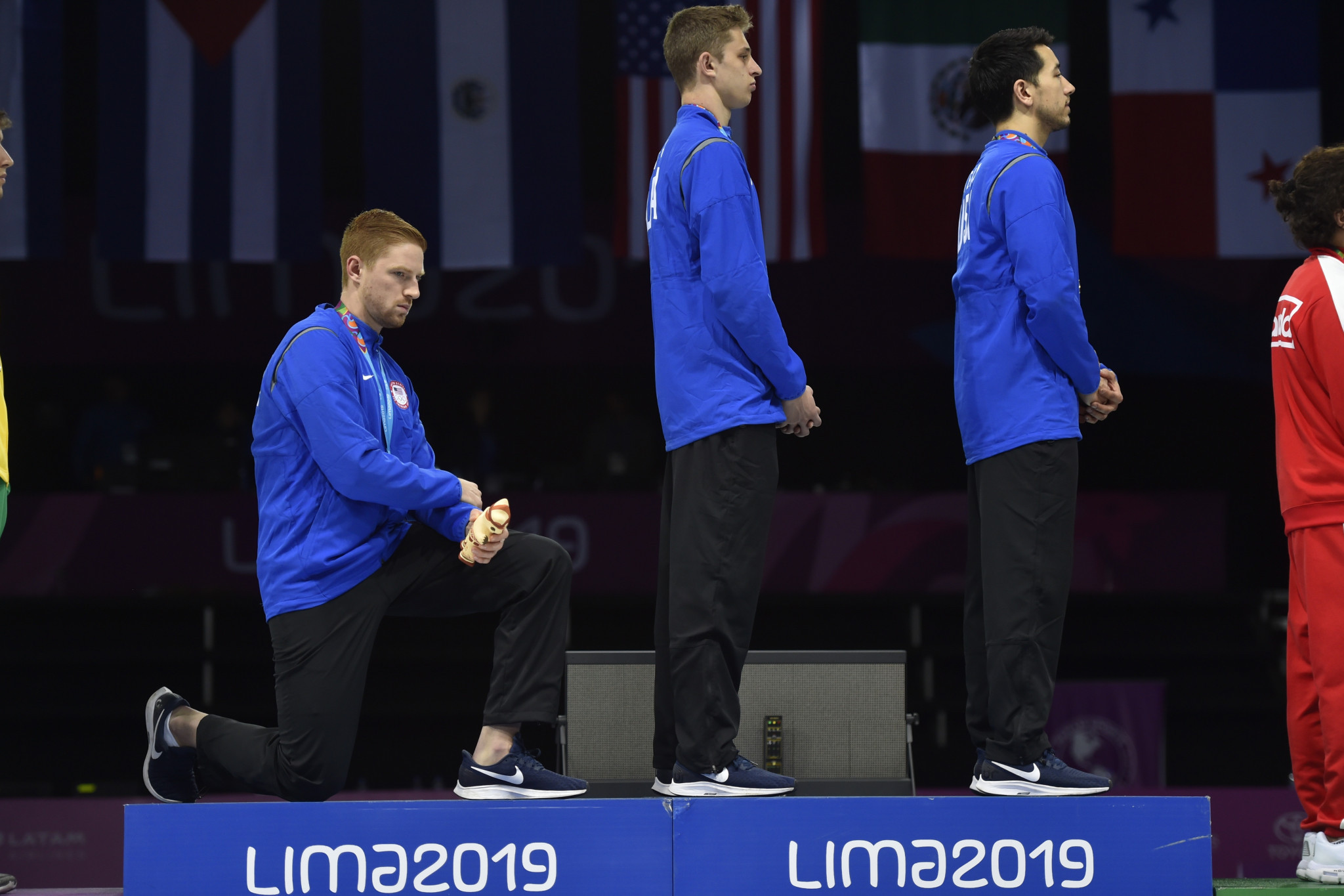 Olympic bronze medallist US fencer Race Imboden makes his protest against racism and gun laws back home after winning team gold at this summer's Pan American Games ©Getty Images