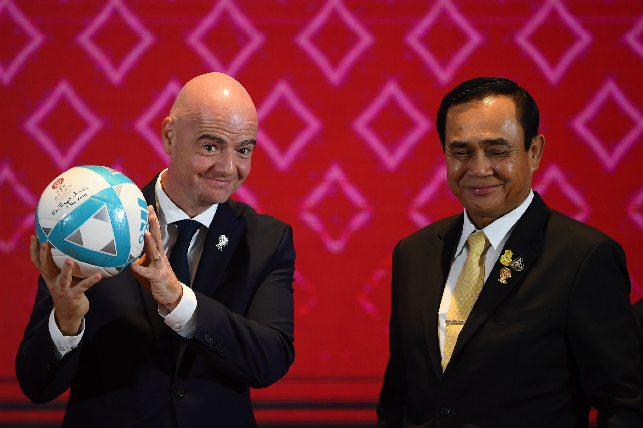 Gianni Infantino holds a football alongside Thailand's Prime Minister Prayut Chan-O-Cha ©Getty Images
