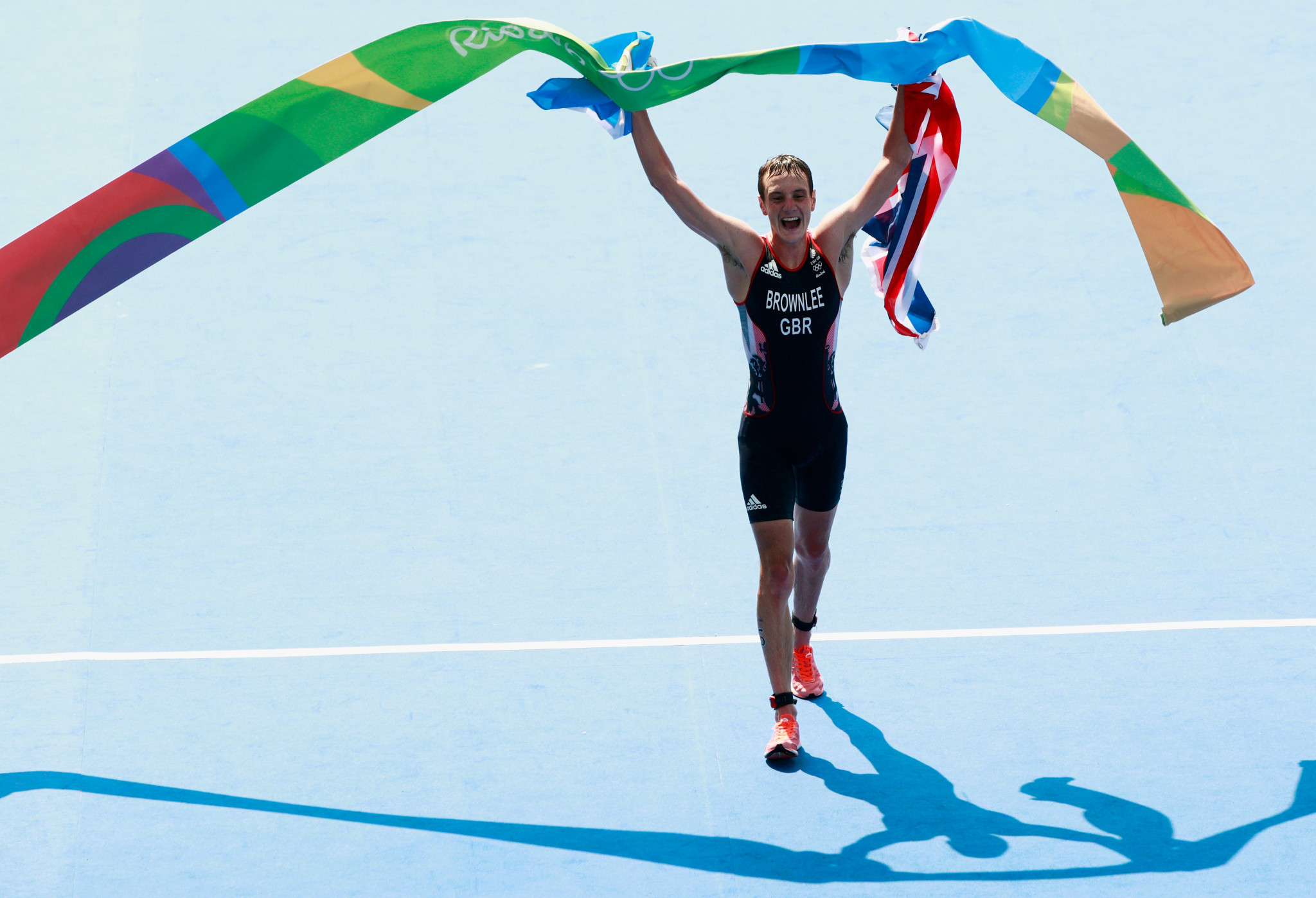 Britain's Alistair Brownlee celebrates winning a second consecutive Olympic gold medal in the triathlon at Rio 2016 - he has not yet decided whether he will attempt to win a third at Tokyo 2020 ©Getty Images