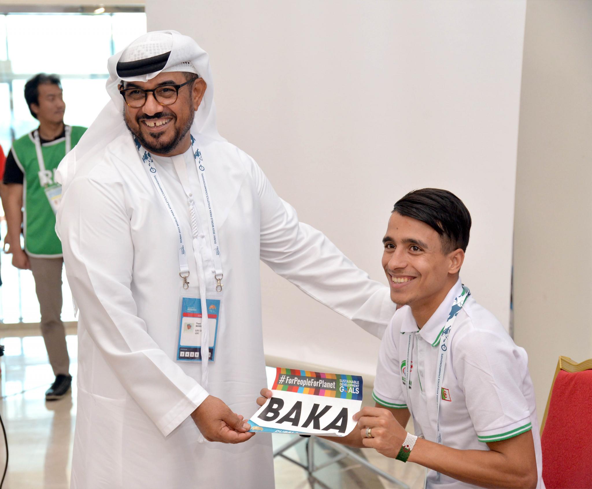 Algerian runner Abdellatif Baka received his bib from Dubai 2019 Organising Committee chairman, Thani Juma Berregad ©Dubai 2019
