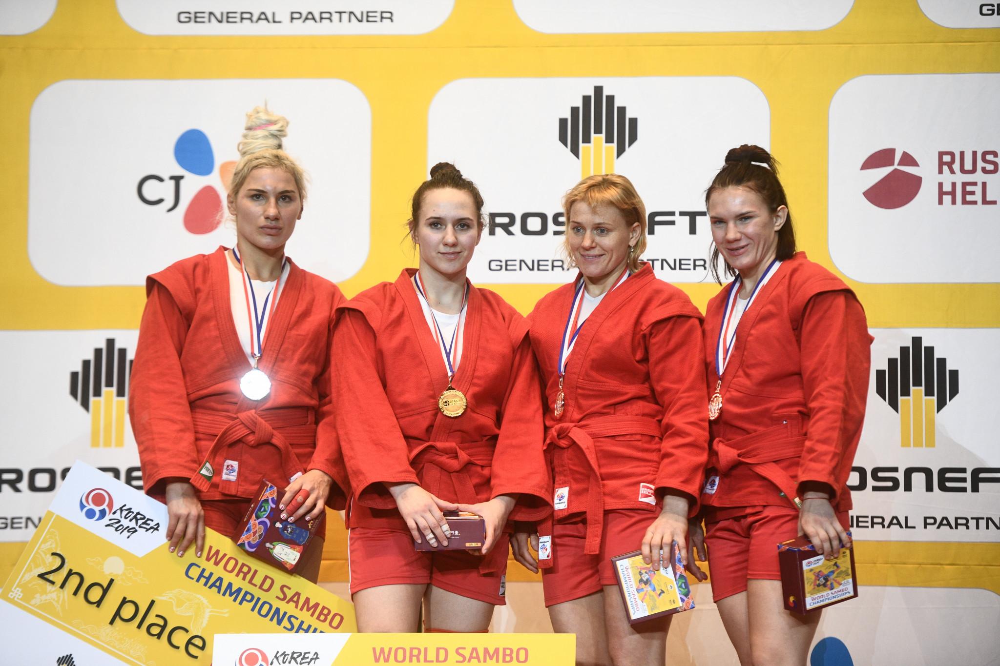 Anastasiia Khomiachkova of Russia, second left, topped the podium in the women's 72kg World Sambo Championship ©FIAS