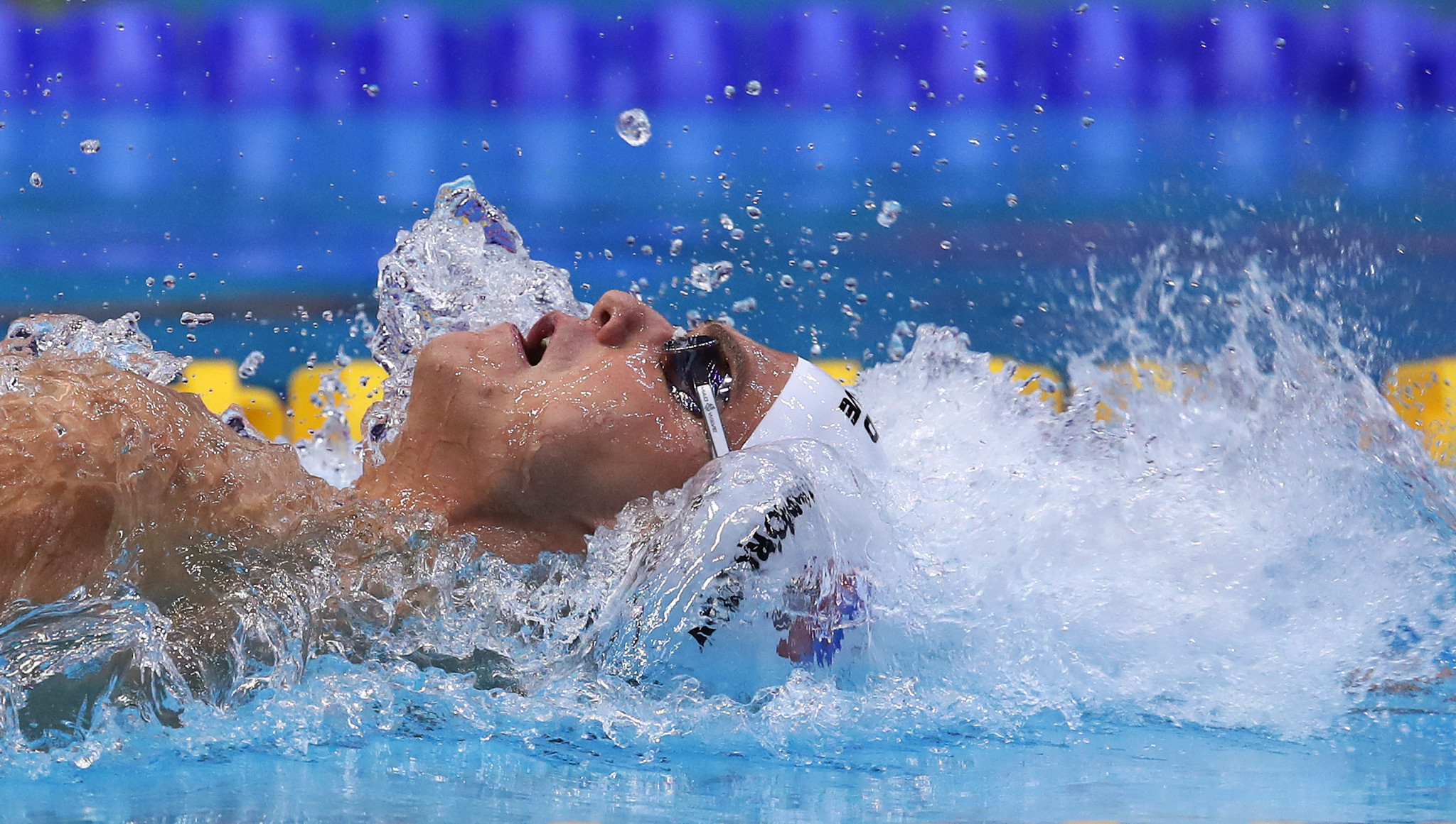 Morozov wins again as Romanchuk breaks record at FINA World Cup