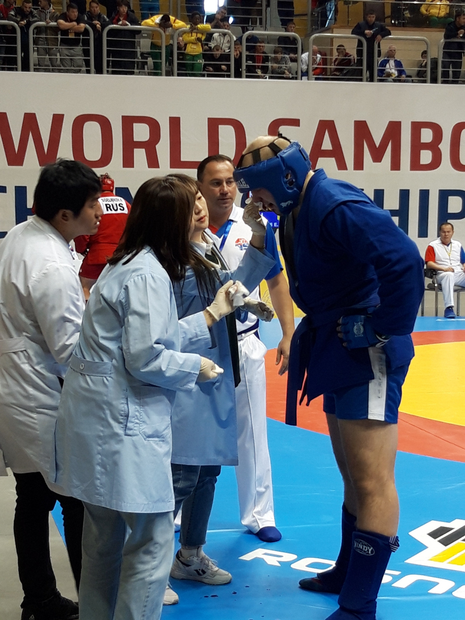 Eimantas Vaikasas of Lithuania receives medical support in the combat sambo over 100kg preliminary rounds ©ITG