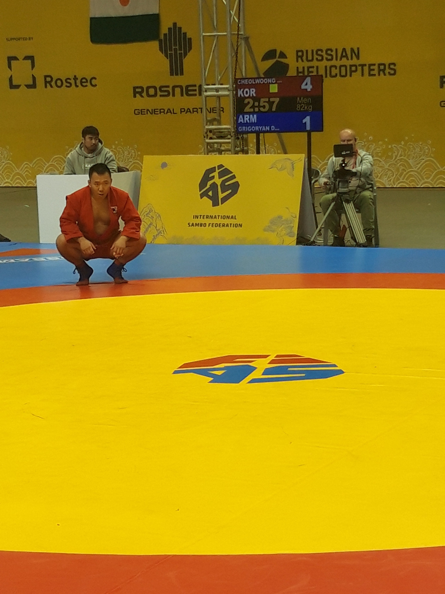 South Korean sambist Cheonwoong An awaits a refereeing call in the men's 82kg preliminary round ©ITG