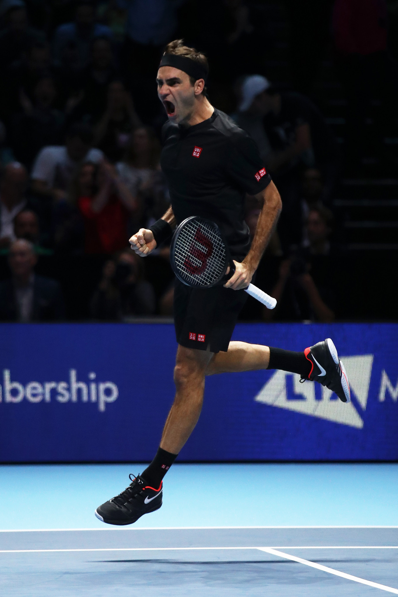 Roger Federer leaps for joy after beating Novak Djokovic to reach the last four of the ATP Finals ©Getty Images