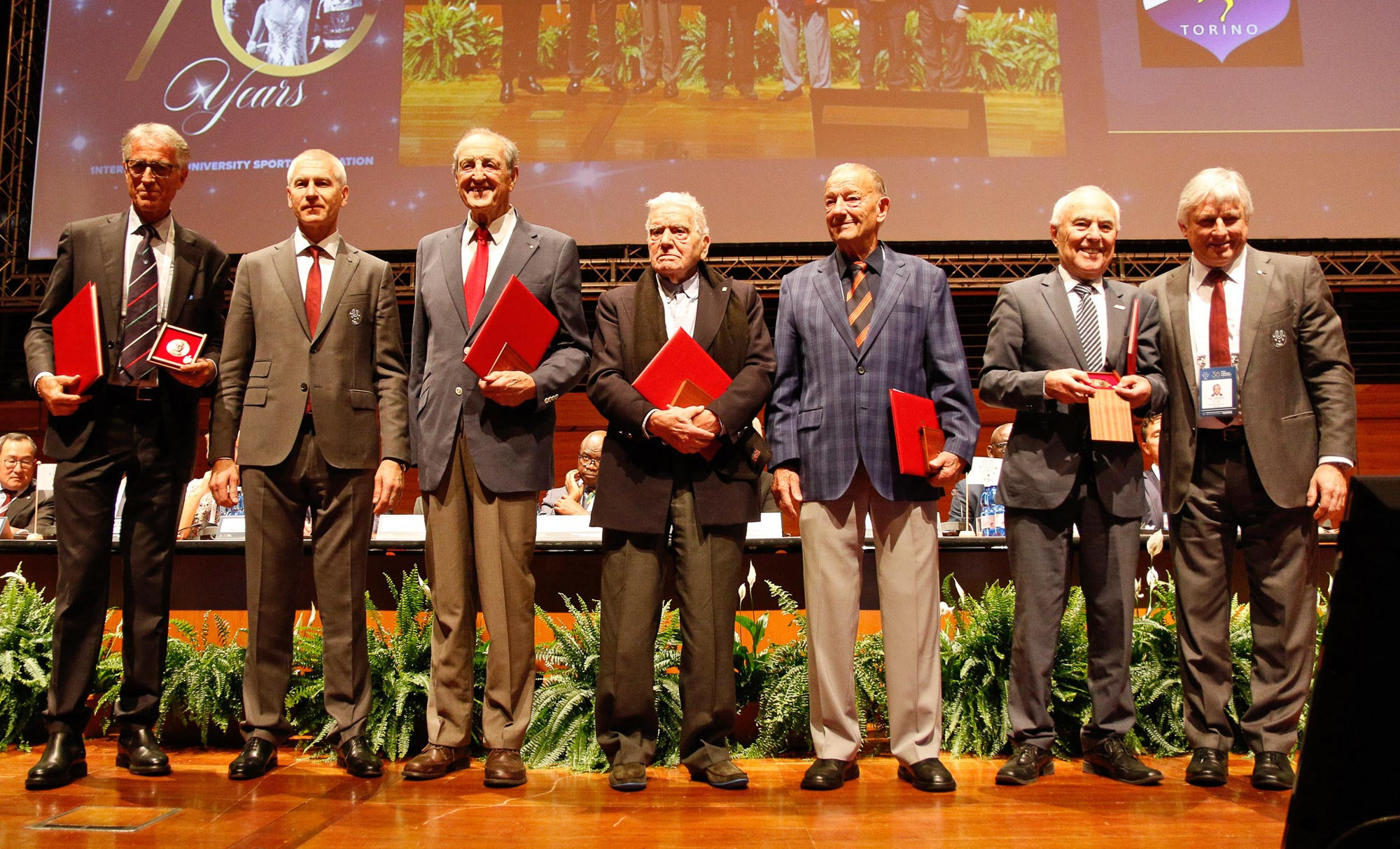 The inaugural winners of the Primo Nebiolo medals accept the congratulations of the General Assembly ©FISU