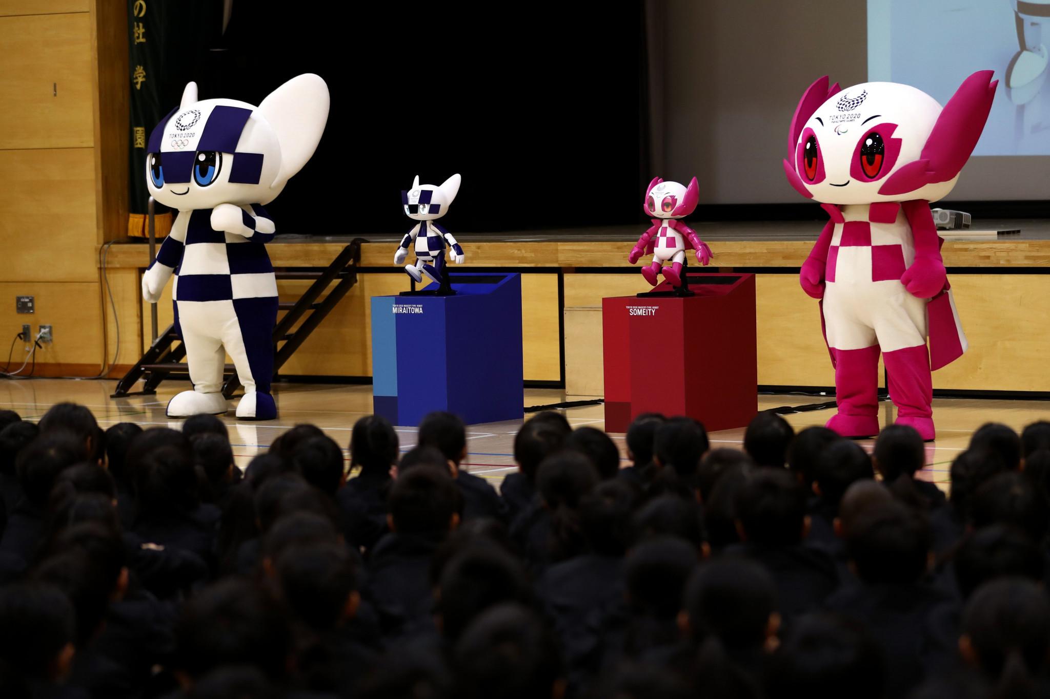 Tokyo 2020 demonstrate mascot robots with school pupils