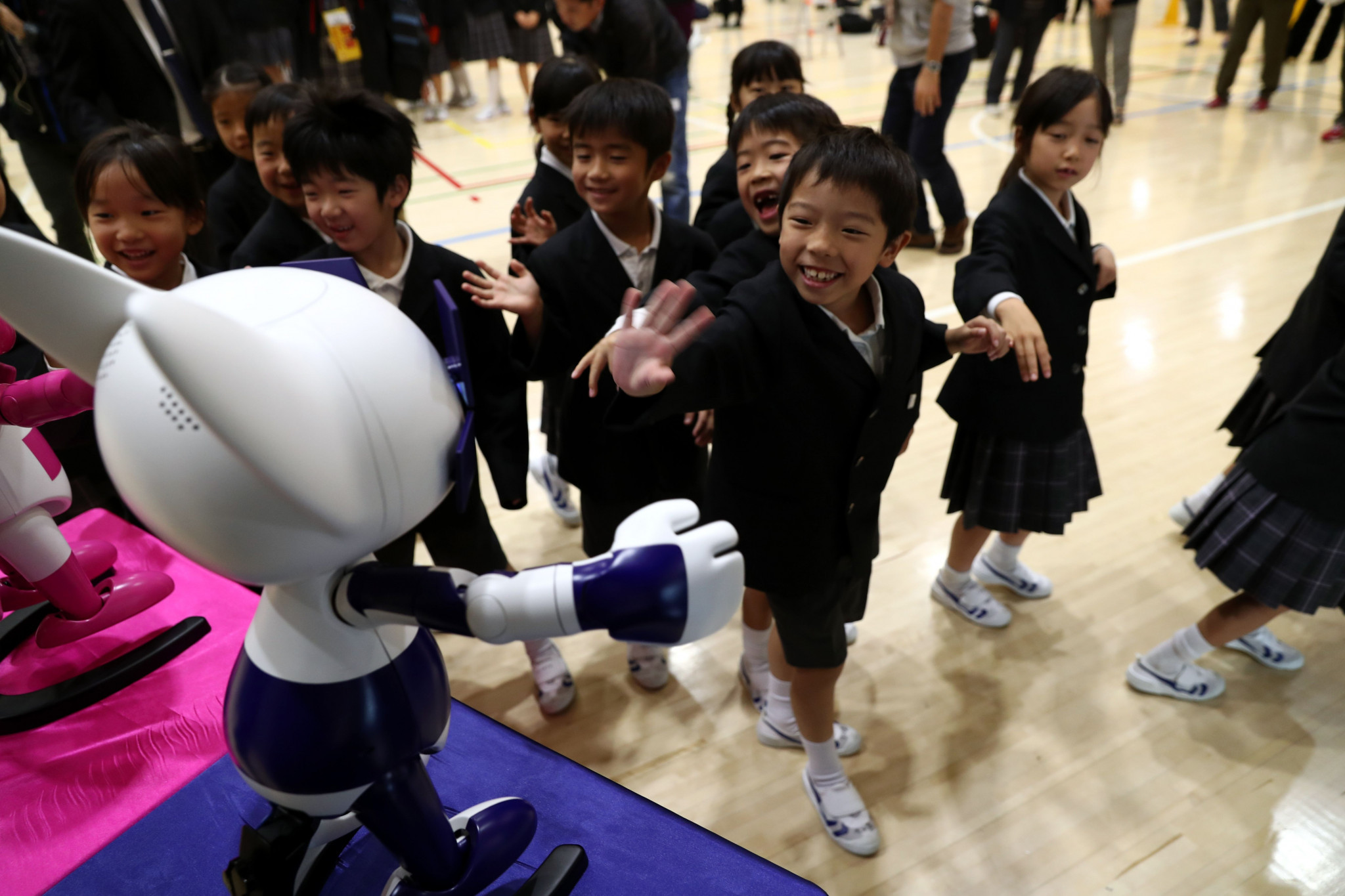 The robots interacted with the children at the school ©Getty Images