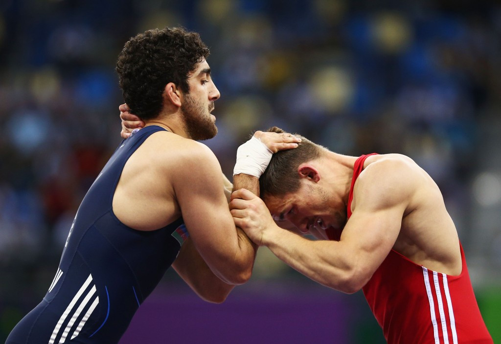Azerbaijan's Olympic champion Togrul Asgarov suffered a shock loss to the disappointment of the home crowd