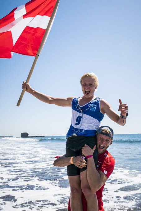 Christian Andersen is lifted by ISA vice-president and training partner Casper Steinfath after winning gold ©ISA