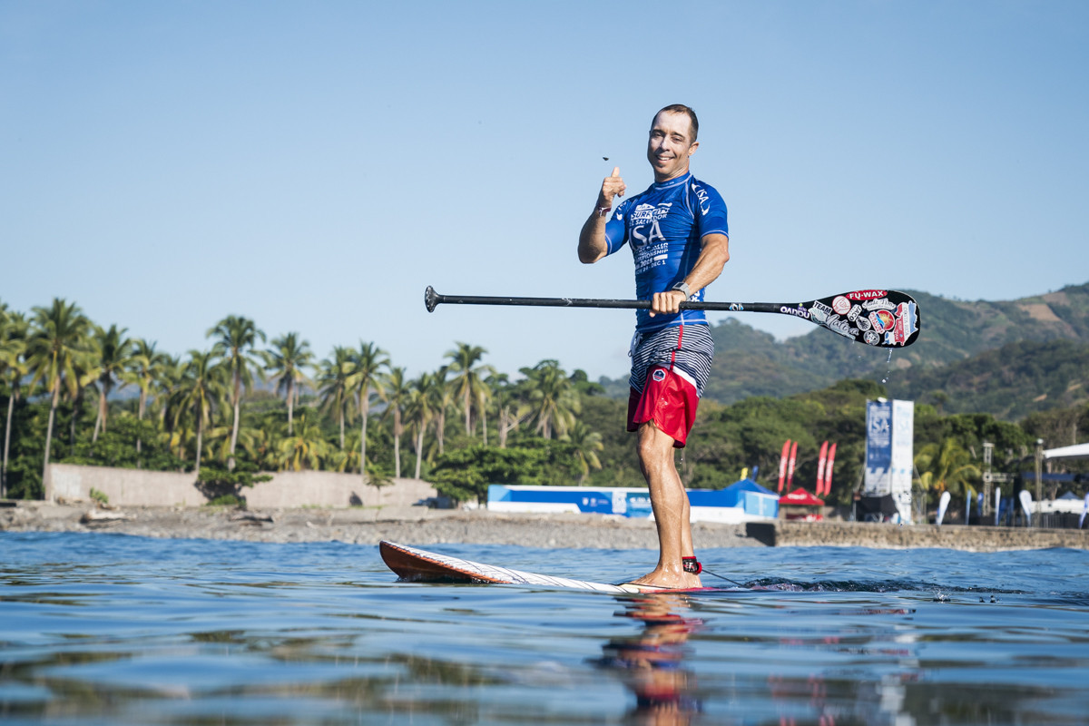 Waves crank up a notch as SUP surfing preliminaries begin at Surf City