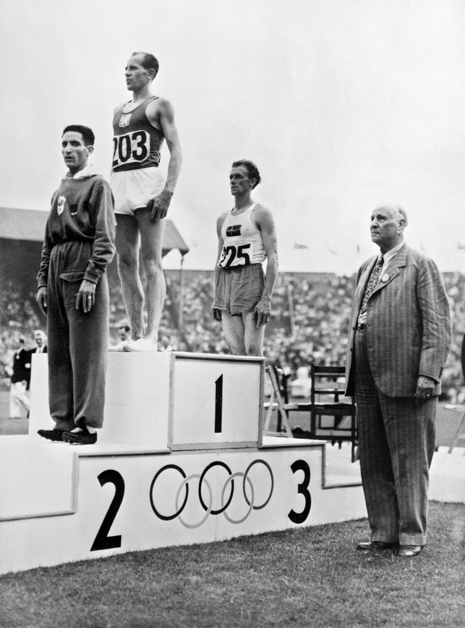 The way it was for two Olympics - Czechoslovakia's Emil Zatopek tops the podium after the 10,000m final at London 1948, with French rival Alain Mimoun in silver medal position ©Getty Images