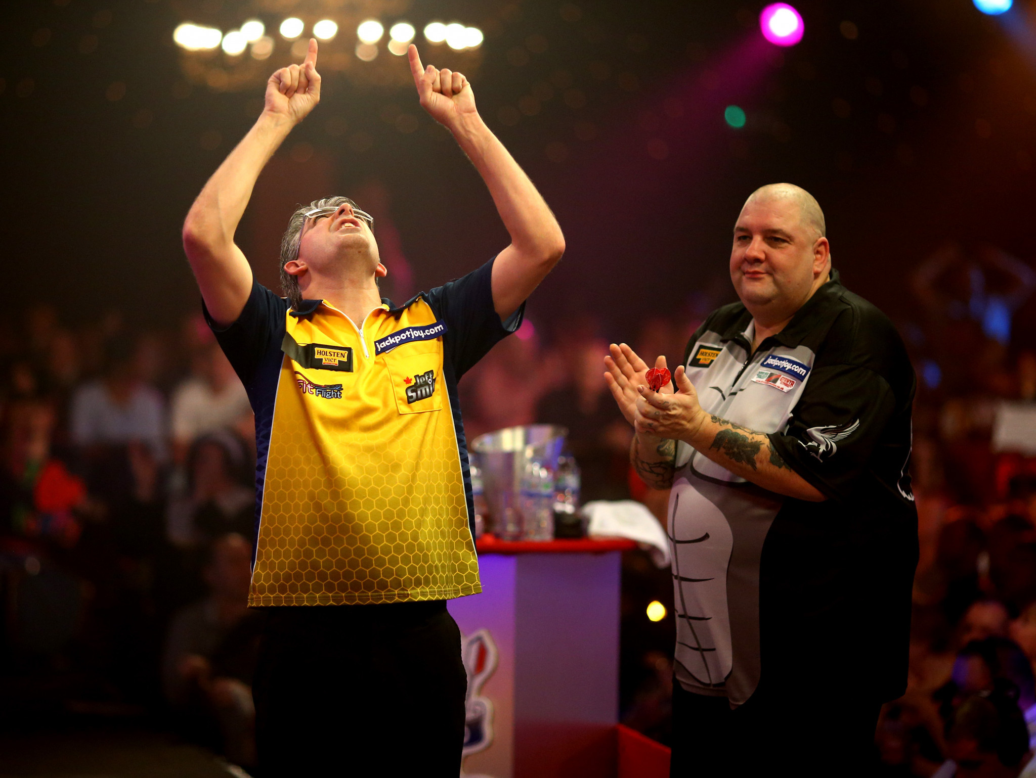 The way it was - Jeff Smith of Canada celebrates winning his quarter final match against Robbie Green of England during the BDO World Championships of 2014 at their old venue of the Lakeside Country Club ©Getty Images