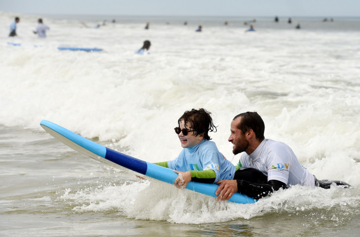 A young blind boy benefits from a See Surf event at the Lacanau beach in south-west France held last year ©Getty Images
