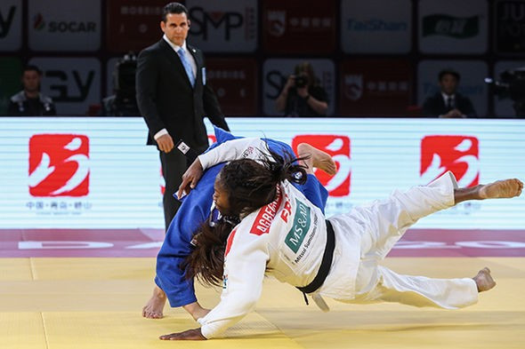 Nami Nabekura of Japan upset world champion Clarisse Agbegnenou in the women's under-63kg final ©IJF