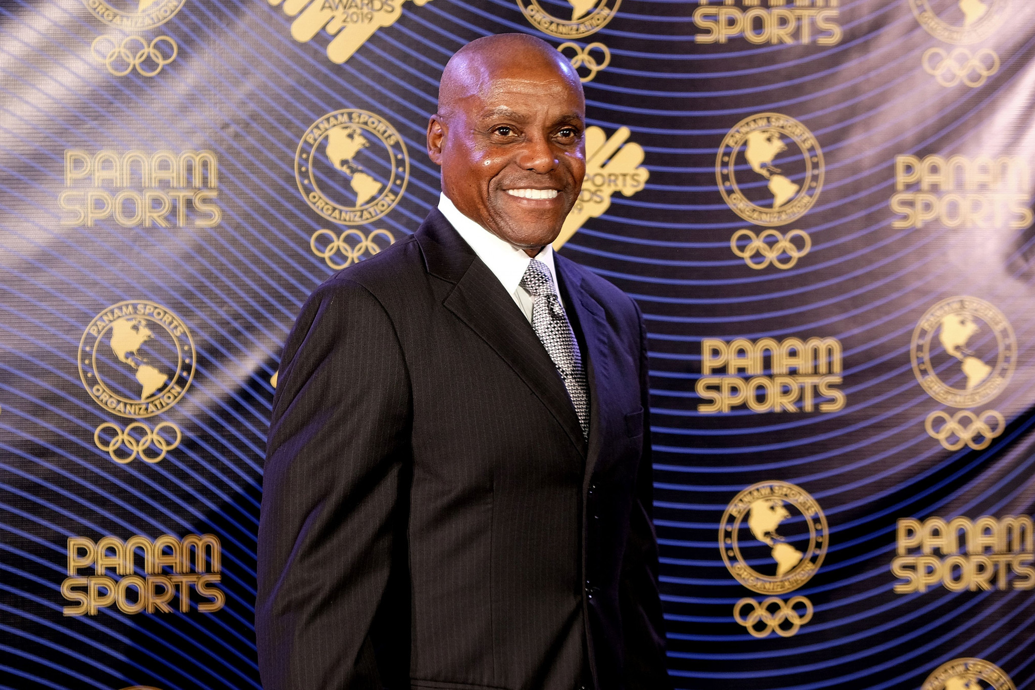 American athletics great Carl Lewis received the Panam Sports legend award ©Getty Images