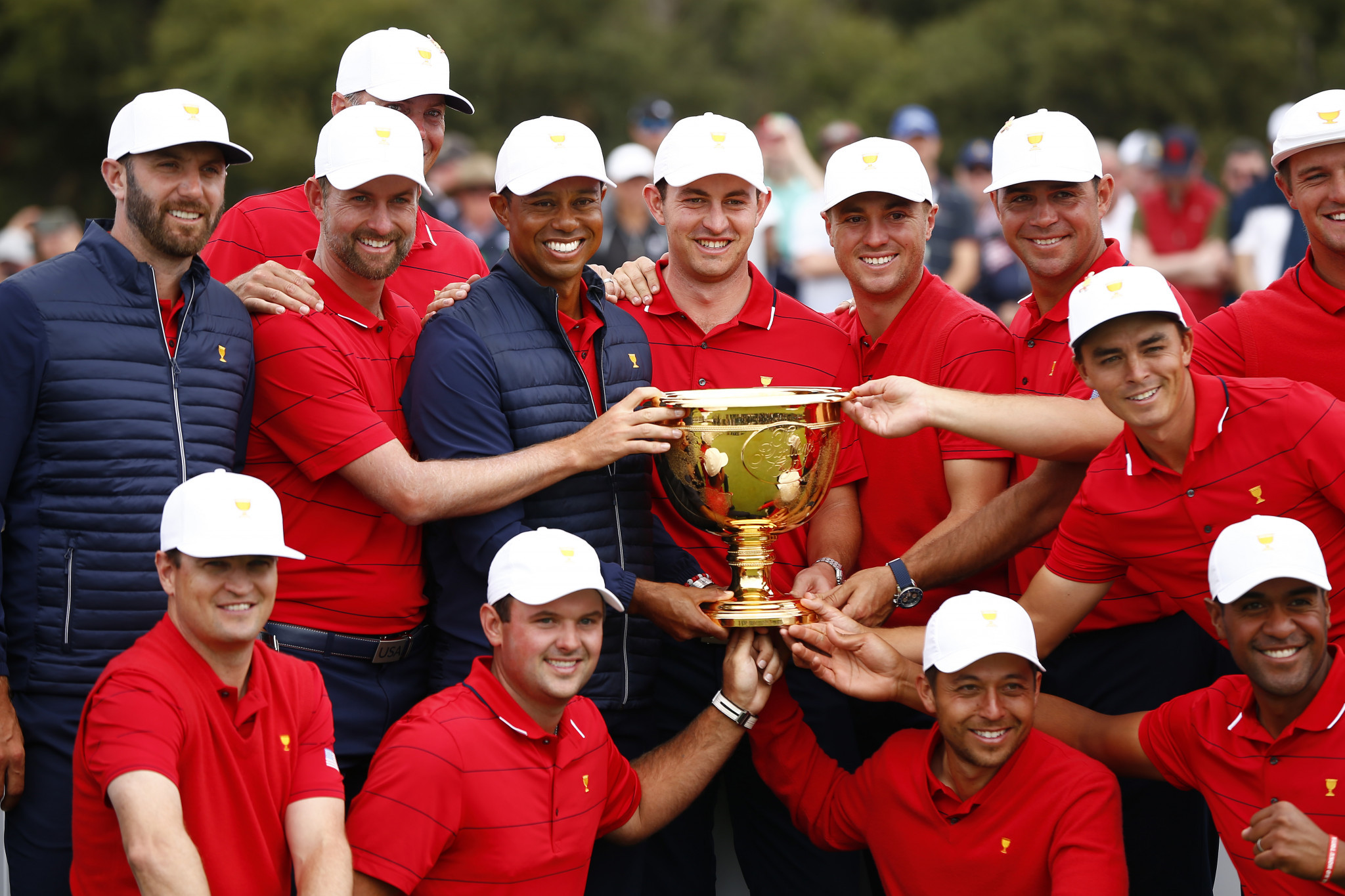 Woods stars as United States fight back to retain Presidents Cup