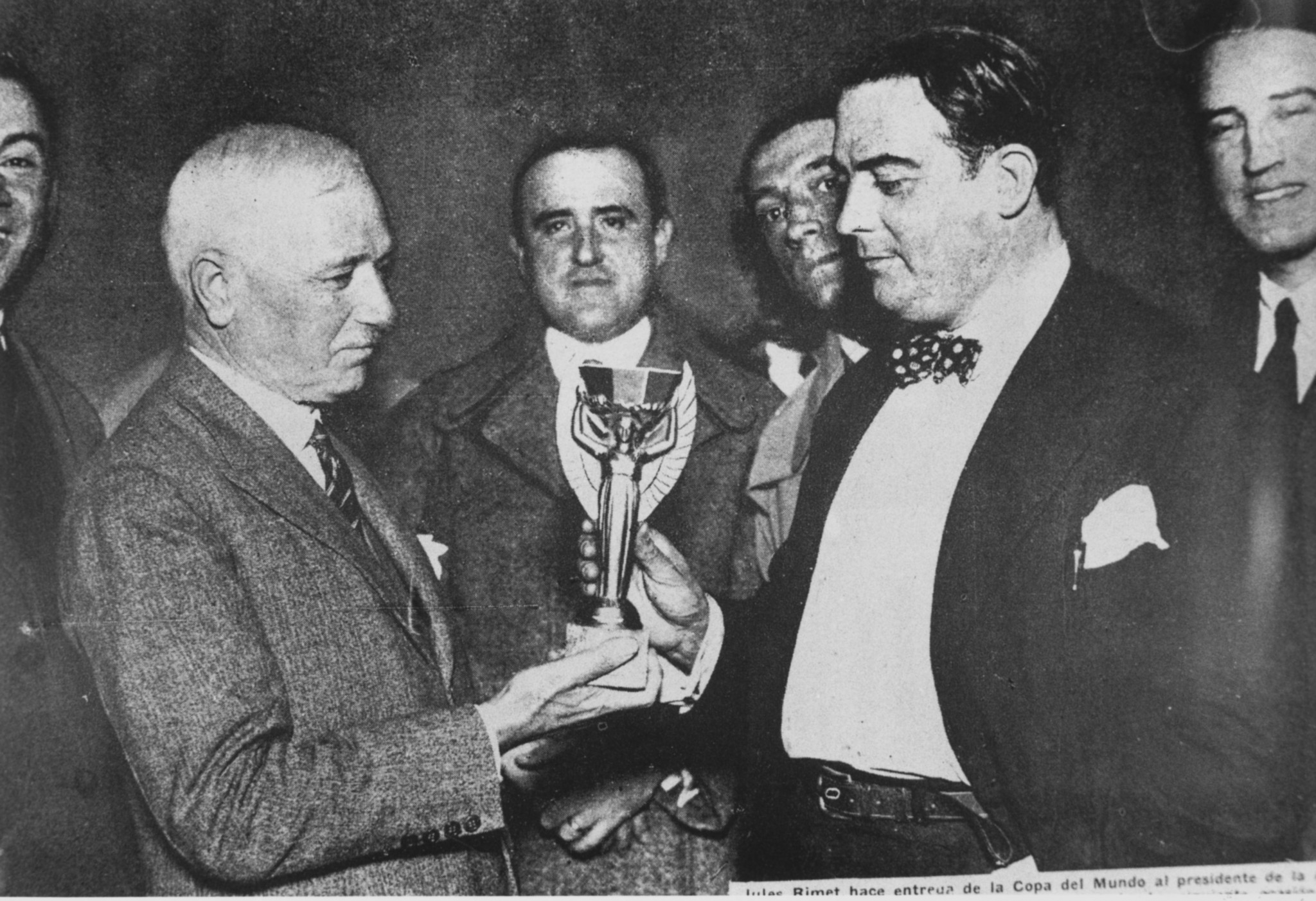 Jules Rimet, FIFA President, presents the 1930 trophy to Dr Paul Jude, the President of the Uruguayan Football Association - a key year in the history of the game ©Getty Images