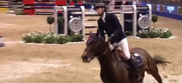 Switzerland's Fuchs guides The Sinner to victory in FEI Jumping World Cup at Olympia