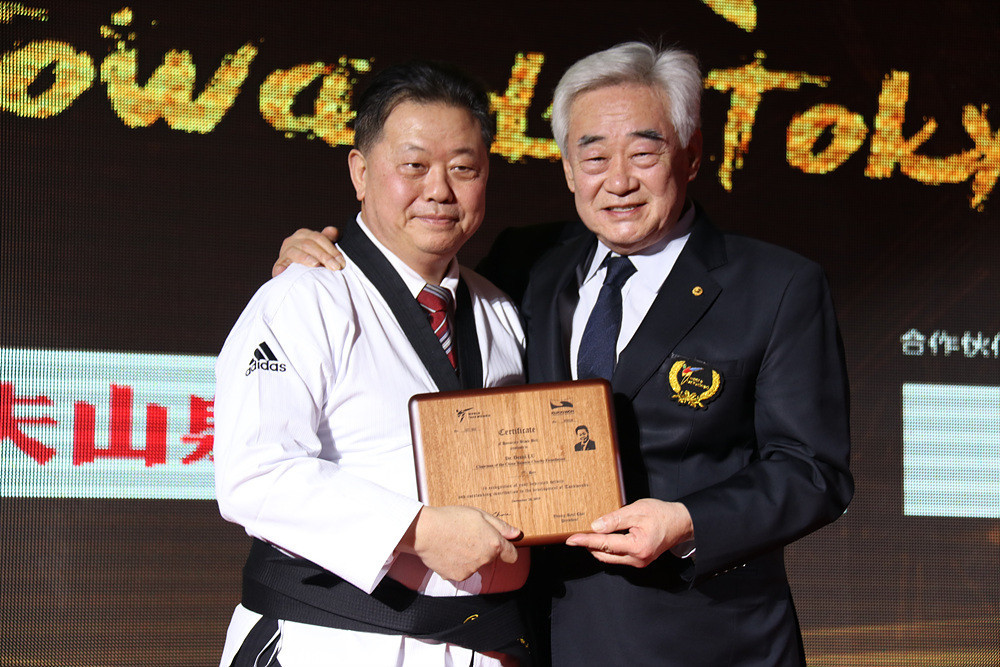 Taekwondo Humanitarian Foundation supporter honoured with black belt certificate