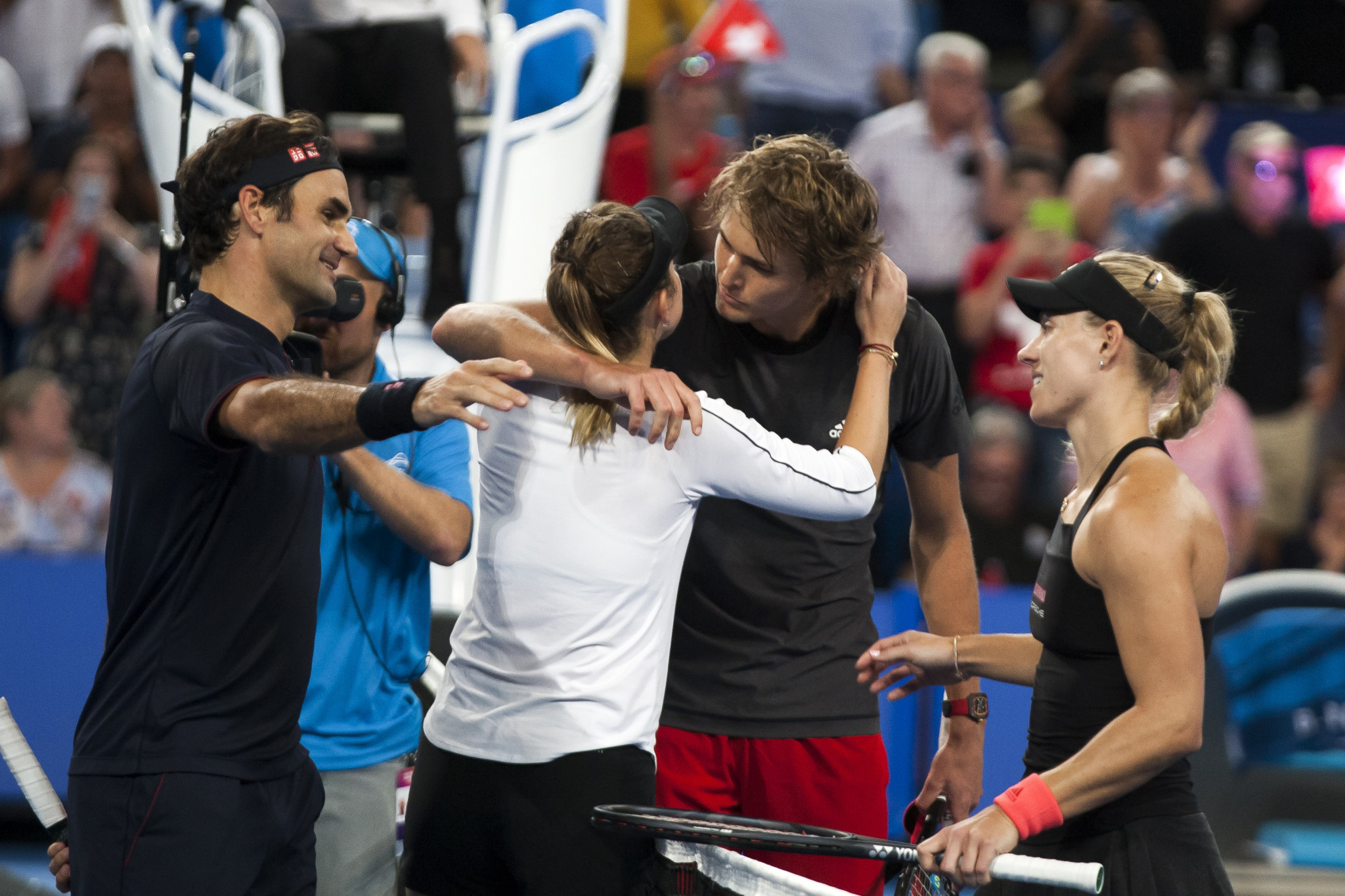 Angelique Kerber, right, with Alexander Zverev, second right after playing in the Hopman Cup this year against Roger Federer and Belinda Bencic - a partnership they may renew for Tokyo 2020 ©Getty Images