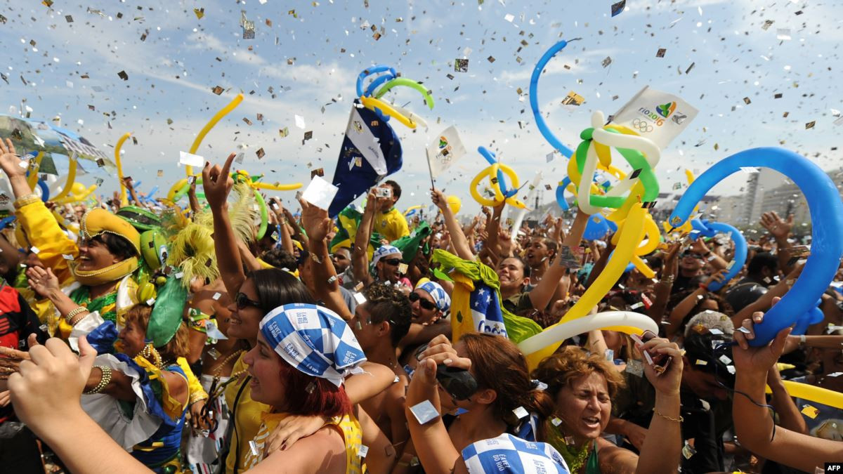 Crowds on Copacabana celebrate Rio de Janeiro being awarded the 2016 Olympic and Paralympic Games in 2009 - a decision that heralded problems for the IOC in this decade ©Getty Images