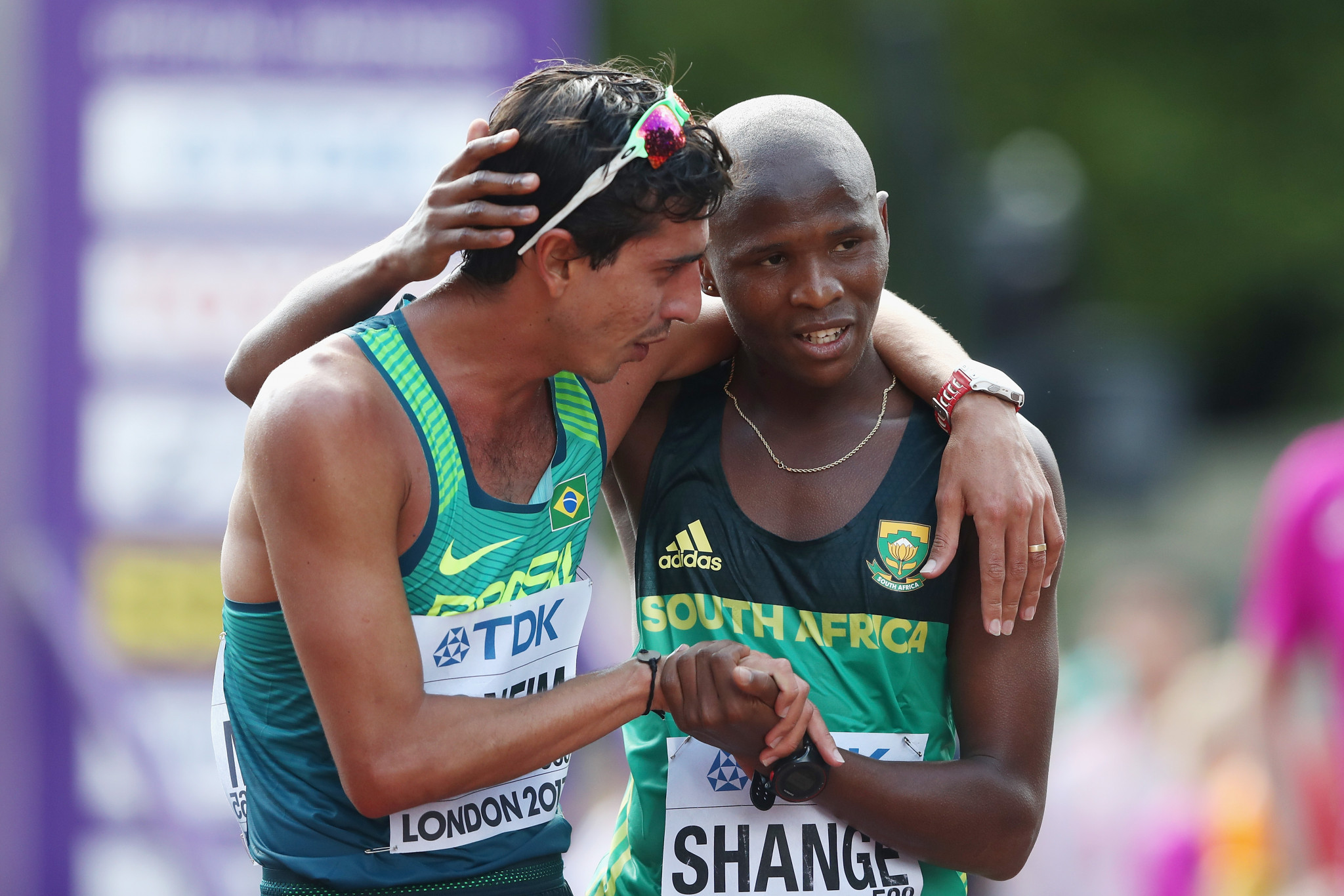 Lebogang Shange is consoled after he narrowly missed a medal at the 2017 IAAF World Championships in London, finishing fourth in the 20km race walk ©Getty Images