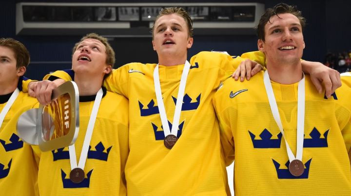 Sweden celebrate a 3-2 win over 2019 IIHF World Junior Championship winners Finland in the third place playoff ©IIHF