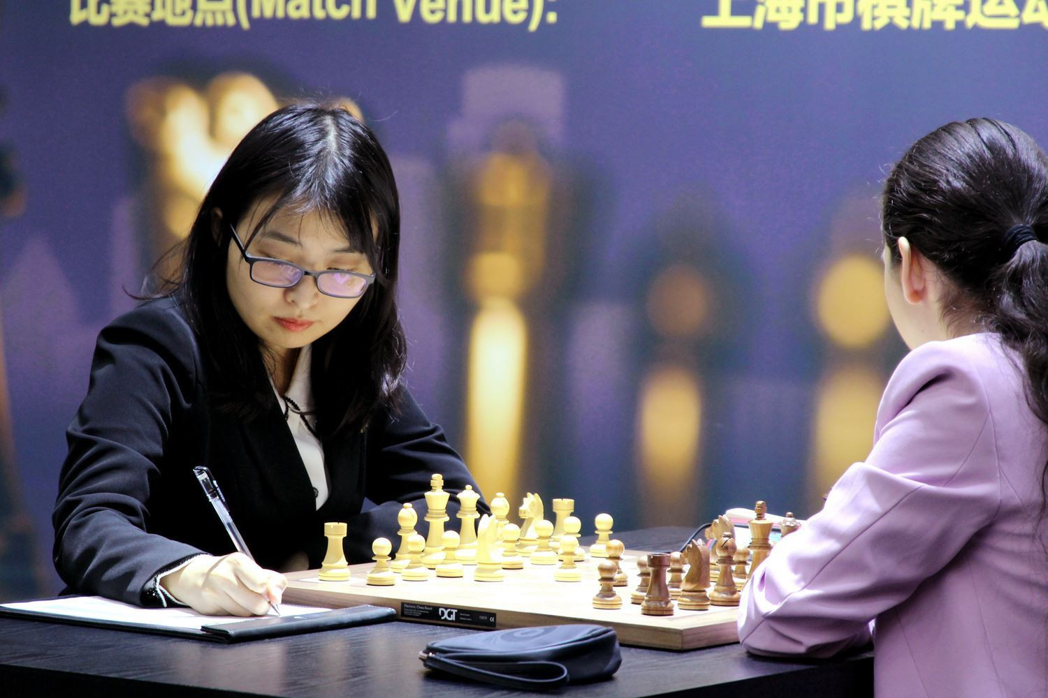 Defending champion Ju Wenjun played with the white pieces on day two ©FIDE