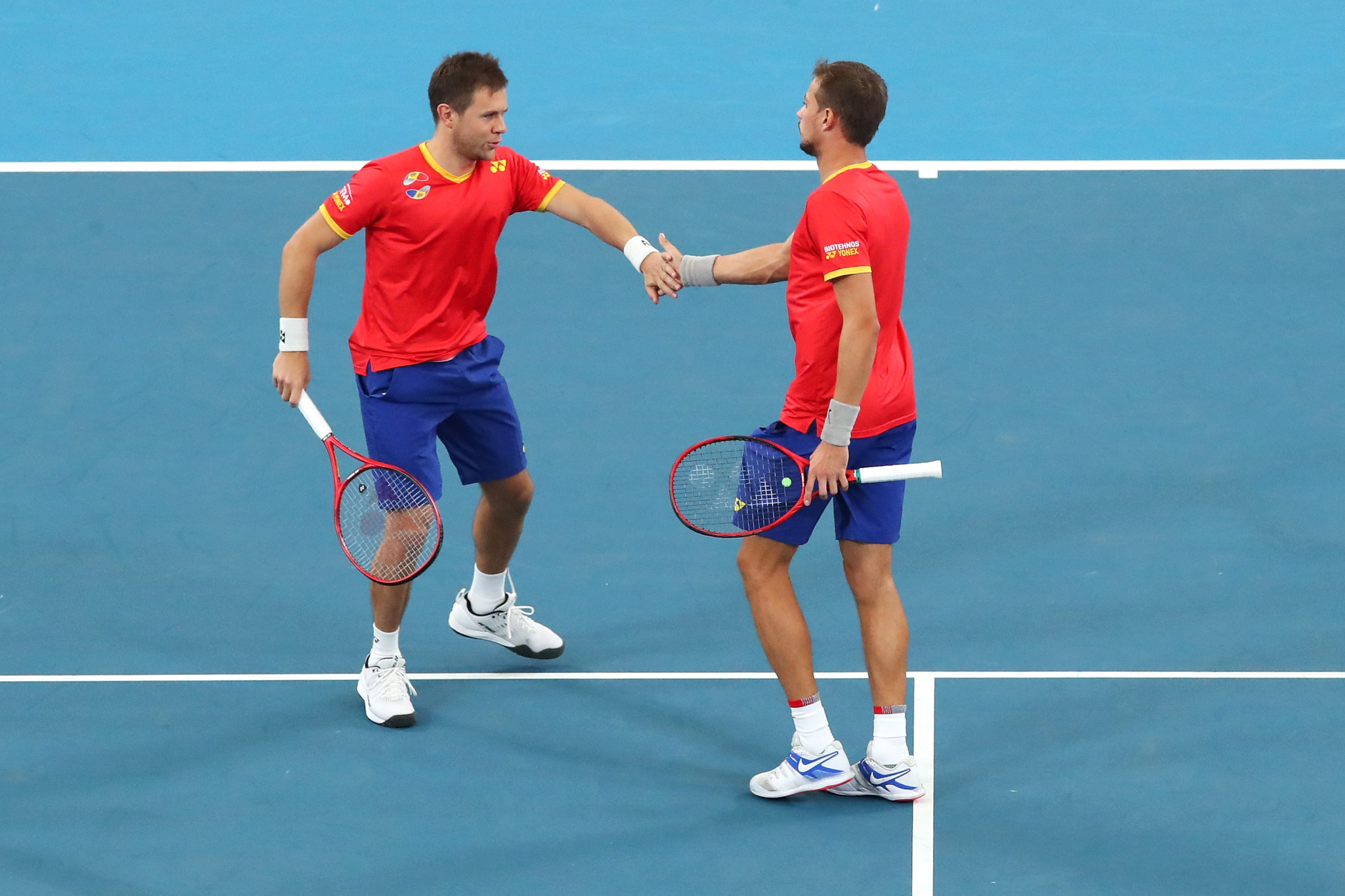 Moldova's Radu Albot and Alexander Cozbinov in action at the ATP Cup  in Australia - having heard the Romanian anthem mistakenly played to them before their opening match ©Getty Images