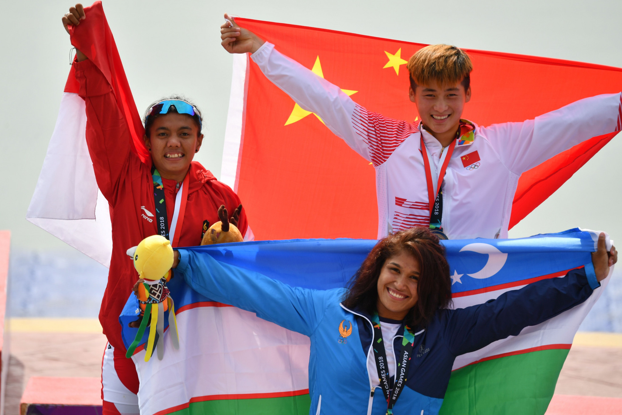 Dilnoza Rakhmatov, pictured centre after winning canoe sprint bronze at the 2018 Asian Games, has been named Uzbekistan's Female Athlete of 2019 at the end of a year where she earned world bronze in the C2-200m doubles event.