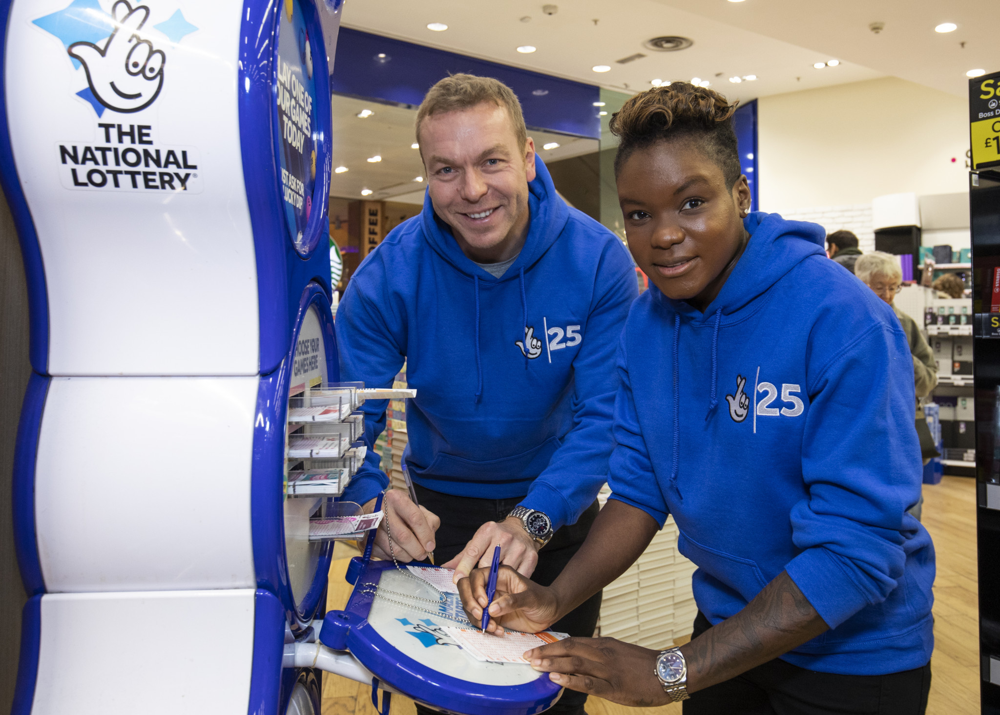 Nicola Adams, pictured here alongside Sir Chris Hoy, has had a huge effect on the popularity of female boxing in the UK ©Getty Images