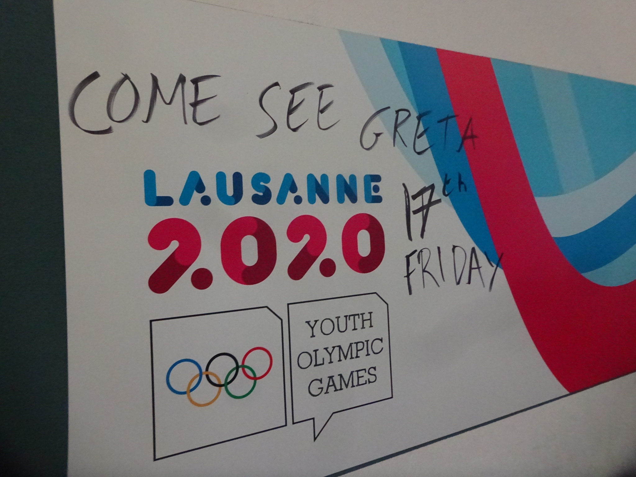 Graffiti on a Lausanne 2020 sign notes Greta Thunberg's expected arrival ©ITG