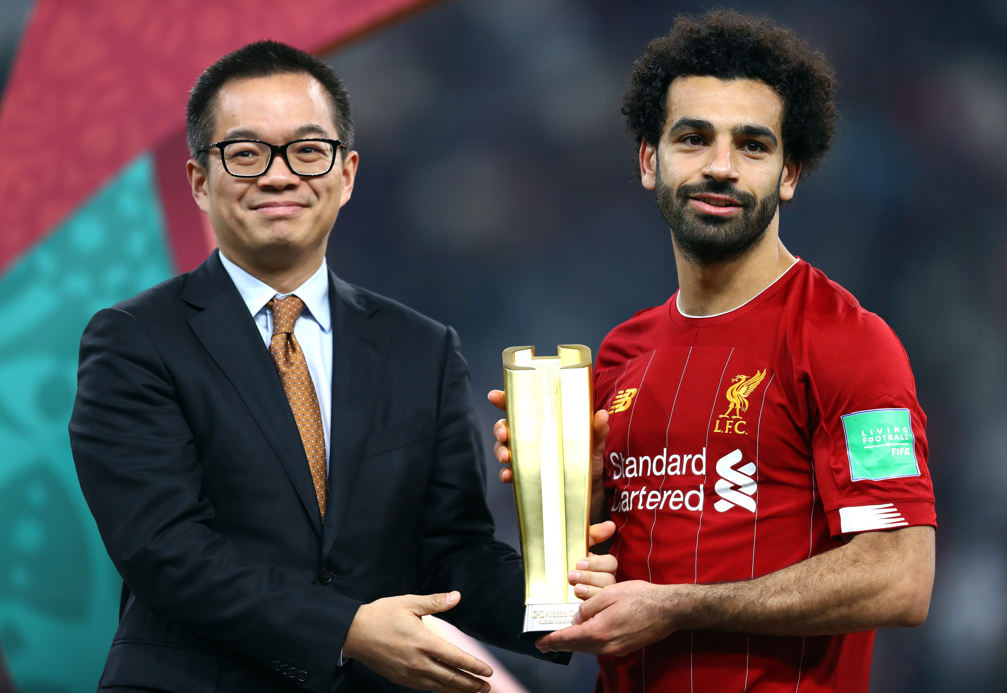 Liverpool's Mo Salah receives the Alibaba Cloud Player of the Tournament at last year's FIFA Club World Cup, showing the ambition of the company ©Getty Images